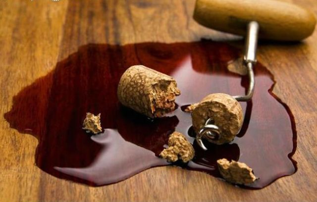 corkscrew_and_broken_cork_in_pool_of_spilt_red_wine_266323